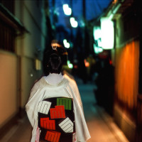 Geisha walking at night to work Kyoto