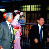 A Maiko with two business man Kyoto Japan