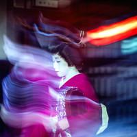 Ghost like Geisha walking gion street Kyoto