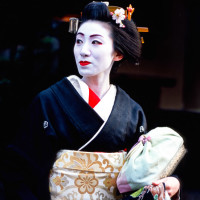 Geisha waiting for taxi in Gion, Kyoto