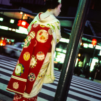 Maiko waiting at red light street in Gion, Kyoto.
