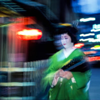ghost like Geisha walking at night in Gion Kyoto