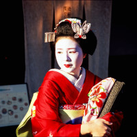 A Maiko standing in front of restaurant Kyoto
