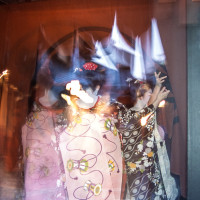 Geisha entering a Tea house