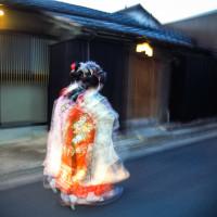 two Kyoto Maiko walking fast Kyoto, Japan