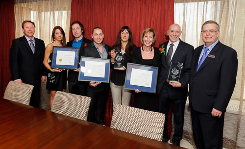 Business people receiving awards